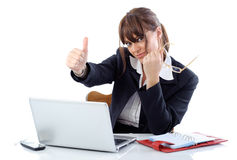 Woman on laptop. Woman with thumb up working on laptop isolated on white Stock Photos