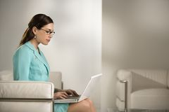 Woman on laptop. Stock Photos