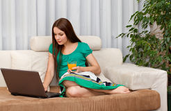 The woman with laptop. The woman with orange juice and laptop Stock Image