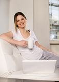 Woman on sofa with laptop Royalty Free Stock Photo