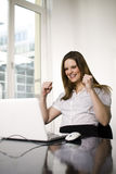 Successful woman using computer Stock Photography