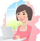 Woman at the laptop. Woman in a pink sweater at work Stock Photos