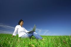 Woman and laptop Stock Images