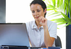 Woman and laptop Royalty Free Stock Image