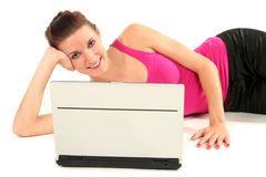 Woman with laptop. Woman lying on floor with laptop Royalty Free Stock Photos