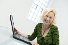 Woman and laptop  Stock Photos