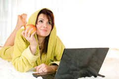 Woman with laptop and apple Stock Photo