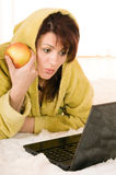 Woman with laptop and apple Royalty Free Stock Photo