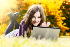 Woman with laptop in autumn scenery Royalty Free Stock Images