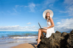 Woman laptop beach. Woman smiling with laptop computer on tropical beach Stock Image