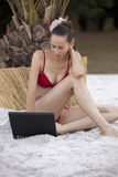 Woman with laptop on the beach Royalty Free Stock Images