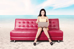 Woman with laptop in the beach Royalty Free Stock Image