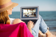 Woman with laptop on the beach Royalty Free Stock Photography