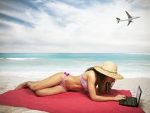 Woman with laptop on beach Stock Photo