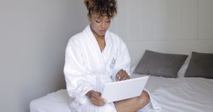Woman with laptop in bed stock video