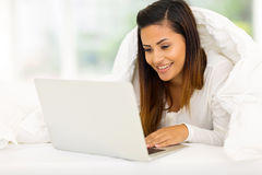 Woman laptop bed Royalty Free Stock Photo
