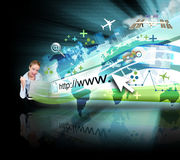 Woman on Laptop with Black Internet Projection. A young business woman is sitting on the ground with a laptop and an abstract internet address is popping out