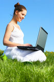 Woman, laptop and blue sky Stock Image