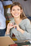 Woman With Laptop And Books Smiling In College Royalty Free Stock Photography