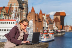 Woman with laptop on the bridge Royalty Free Stock Image