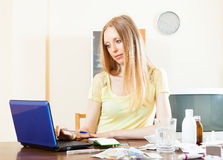 Woman with laptop, buying medications in internet Royalty Free Stock Photography