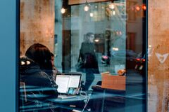 Woman on laptop in cafe Stock Photo