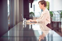 Woman with laptop in cafe Stock Photography