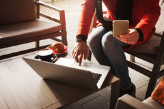 Woman with laptop at the cafe Stock Images