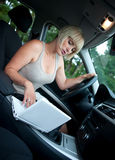 Woman with laptop in the car Stock Photography