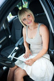Woman with laptop in car Royalty Free Stock Images