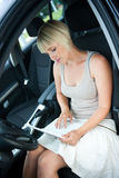 Woman with laptop in car Stock Photography
