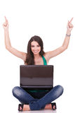Woman with laptop celebrating Stock Images
