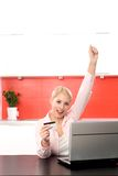 Woman with Laptop Cheering Royalty Free Stock Photography