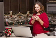 Woman with laptop in Christmas kitchen Royalty Free Stock Images