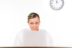 Woman with laptop and clock Stock Photo
