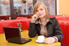 Woman with laptop and coffee Stock Photography