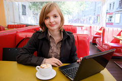 Woman with laptop and coffee Royalty Free Stock Images