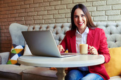 Woman with laptop and coffee in cafe Stock Photography