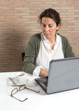 Woman at laptop with coffee cup Royalty Free Stock Image