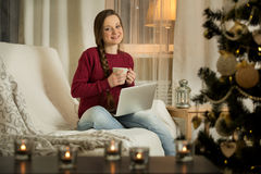 Woman with laptop and coffee Royalty Free Stock Image