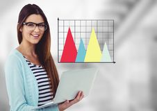 Woman with laptop and colourful graph against blurry grey stairs Royalty Free Stock Images
