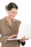 Woman with laptop computer. Portrait of mature businesswoman using laptop isolated on white background Royalty Free Stock Image
