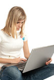 Woman with laptop computer. White background Royalty Free Stock Photography