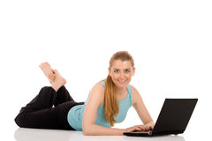 Woman and laptop computer Royalty Free Stock Photography