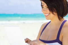 Woman with laptop computer on the beach. Lovely woman with laptop computer on the beach Stock Images
