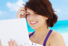 Woman with laptop computer on the beach. Lovely woman with laptop computer on the beach Royalty Free Stock Photos