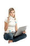 Woman with laptop computer, and cup of coffee Stock Photography