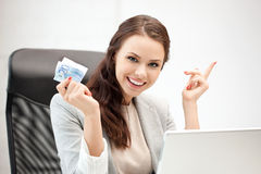 Woman with laptop computer and euro cash money Royalty Free Stock Photos