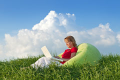 Woman with laptop computer outdoors Royalty Free Stock Photography