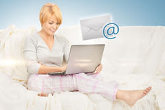 Woman with laptop computer sending e-mail Stock Photo
